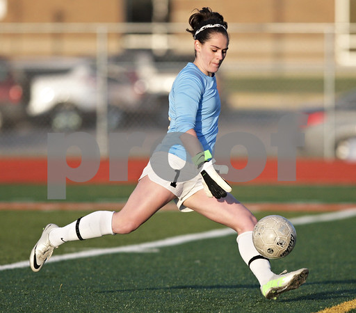 Monica Maschak - mmaschak@shawmedia.com<br /> Kaneland's keeper Jordan Ginther sends the ball into the field during a soccer match at DeKalb High School on Wednesday, April 24, 2013. The game ended with no score.