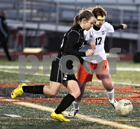 Monica Maschak - mmaschak@shawmedia.com<br /> DeKalb's Danielle Dlabal and Kaneland's Brittany Olson race for possesion of the ball in a soccer match at DeKalb High School on Wednesday, April 24, 2013. The game ended with no score.