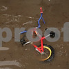 Rob Winner – rwinner@shawmedia.com<br /> <br /> A bicycle is seen in a flooded yard within Evergreen Village Mobile Home Park in Sycamore, Ill., on Thursday, April 18, 2013.