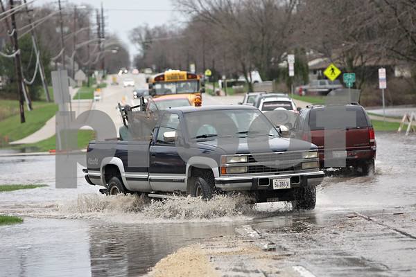 Rob Winner – rwinner@shawmedia.com<br /> <br /> A pickup truck heads west on the flooded Taylor Street near Lions Park in DeKalb, Ill., Thursday, April 18, 2013.