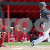 Monica Maschak - mmaschak@shawmedia.com<br /> Jamison Wells swings and misses during a game against Miami of Ohio at Ralph McKenzie Field on Saturday, April 27, 2013. The Huskies won 4-3.