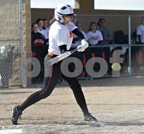 Monica Maschak - mmaschak@shawmedia.com<br /> DeKalb's Jessica Townsend swing for the ball during a game against Kaneland at DeKalb High School on Thursday, April 25, 2013. The Knights beat the Barbs 4-3.