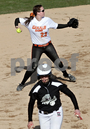 Monica Maschak - mmaschak@shawmedia.com<br /> Sarah Friedlund, with DeKalb, plays the ball in attempt to get out an opponent during a game against Kaneland at DeKalb High School on Thursday, April 25, 2013. The Knights beat the Barbs 4-3.