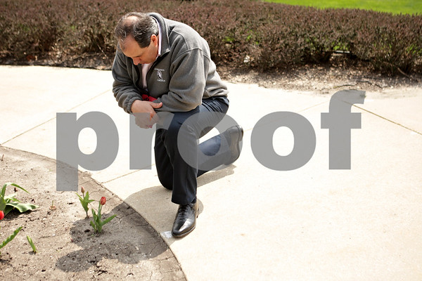 Rob Winner – rwinner@shawmedia.com<br /> <br /> Pastor William Mills, of Bethel Assembly of God in Sycamore, kneels down to pray during the National Day of Prayer event outside the DeKalb County Courthouse in Sycamore, Ill., Thursday, May 2, 2013.