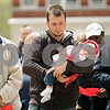 Rob Winner – rwinner@shawmedia.com<br /> <br /> Sycamore resident Thomas Traynoff (center) prays while holding his 8-month-old daughter, Neriah, during the National Day of Prayer event outside the DeKalb County Courthouse in Sycamore, Ill., Thursday, May 2, 2013.