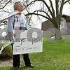 Rob Winner – rwinner@shawmedia.com<br /> <br /> Priest associate Joyce Beaulieu stands near Normal Road outside St. Paul's Episcopal Church waiting to offer snacks and prayers to anyone who passed during the church's #Prayers2Pass event in DeKalb, Ill., Tuesday, April 30, 2013.