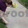 Rob Winner – rwinner@shawmedia.com<br /> <br /> Rochelle Cripe uses chalk to inform passersby of St. Paul's Episcopal Church of Tuesday's #Prayers2Pass event in DeKalb, Ill. St. Paul's Episcopal Church and Grace Place Campus Ministry offered #Prayers2Pass, an interactive prayer event for the students, faculty and staff of Northern Illinois University and anyone else who needs a prayer in the week leading up to finals.