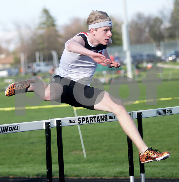Monica Maschak - mmaschak@shawmedia.com<br /> DeKalb's Tyler Peterson competes in the third heat of the 110 meter hurdles at the Sycamore Gib Seegers Classic for boys track and field on Friday, April 26, 2013.