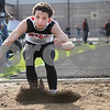 Monica Maschak - mmaschak@shawmedia.com<br /> DeKalb's Adam Wilson marks his landing during the long jump event at the Sycamore Gib Seegers Classic for boys track and field on Friday, April 26, 2013.