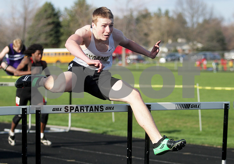 Monica Maschak - mmaschak@shawmedia.com<br /> Sycamore's Tanner Watkins jumps a hurdle in the second heat of the preliminary 110 meter hurdle race at the Sycamore Gib Seegers Classic for boys track and field on Friday, April 26, 2013.
