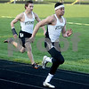 Monica Maschak - mmaschak@shawmedia.com<br /> Sycamore's Dion Hooker races down the track followed by teammate Kevin Maillefer in the final 100 meter dash at the Sycamore Gib Seegers Classic for boys track and field on Friday, April 26, 2013.