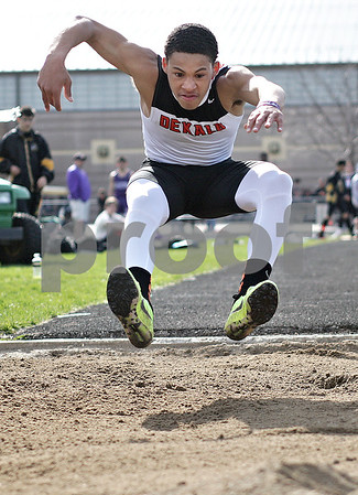 Monica Maschak - mmaschak@shawmedia.com<br /> DeKalb's Antonio Tate prepare to land during the long jump event at the Sycamore Gib Seegers Classic for boys track and field on Friday, April 26, 2013.