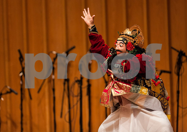 """Erik Anderson - For Shaw Media<br /> <br /> A dancer performs during the Balinese Dance and Gamelan performance during the """"World Music Concert, A Musical Encounter"""" at the Northern Illinois University Music Building on Sunday, April 14, 2013."""