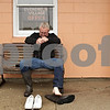 Rob Winner – rwinner@shawmedia.com<br /> <br /> After helping residents from their homes at Evergreen Village Mobile Home Park, Larry Dingler wrings out one of his soaked socks in Sycamore, Ill., on Thursday, April 18, 2013.