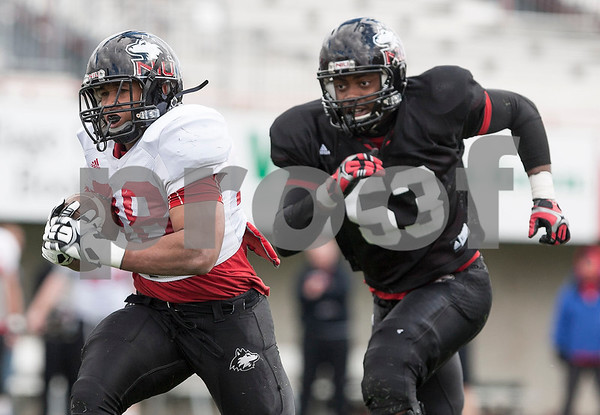 Erik Anderson - For Shaw Media<br /> <br /> Northern Illinois University running back Alex Morrow (left) sprints towards the end zone as the Huskies defensive end Matthew Baltimore chases from behind during the NIU spring game at Brigham Field in Huskie Stadium on Saturday, April 13, 2013.