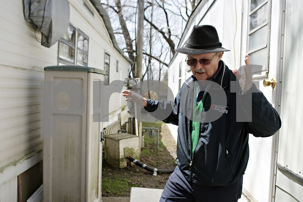 Rob Winner – rwinner@shawmedia.com<br /> <br /> Frank Santoro, owner of Evergreen Village Mobile Home Park in Sycamore, Ill., throws his hands up in frustration while looking over homes that were deemed as having been damage by flood waters from the recent rains on Friday, April 26, 2013.