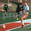 Monica Maschak - mmaschak@shawmedia.com<br /> Kaneland's Brittany Olson leaps into DeKalb's Carlie Hayes after she kicks the ball in a soccer match at DeKalb High School on Wednesday, April 24, 2013. The game ended with no score.