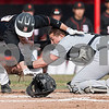 Erik Anderson - For the Daily Chronicle <br /> Sycamore's Nate Haacker (right) tags out DeKalb's Danny Petras at home base during early gameplay action of the Sycamore and DeKalb match up held at NIU's Ralph McKinzie Field on Monday, April 8, 2013.