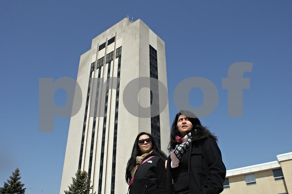 Rob Winner – rwinner@shawmedia.com<br /> <br /> Sarah Cole (left), 17, and her mother Doris Cole, of Aurora,  look around the Northern Illinois University campus outside the Holmes Student Center in DeKalb, Ill., during an open house visit on Friday, March 29, 2013. Doris is an NIU alumna.
