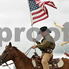 Rob Winner – rwinner@shawmedia.com<br /> <br /> Jay Lerette (left) of Compton and Mark Manning of Durand carry the flags before the start of the Northern Illinois Outlaws' cowboy mounted shooting event at Amber Sun Acres in Malta, Ill., on Saturday, July 27, 2013, as part of Kishwaukee Fest.