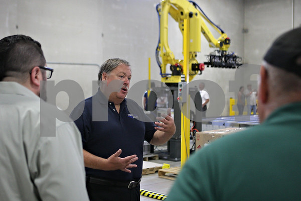 Rob Winner – rwinner@shawmedia.com<br /> <br /> Scott Gilmore, chief executive officer, explains recent developments involving robotic palletizer during an open house at Smart Motion Robotics, Inc. in Sycamore, Ill., Thursday, July 25, 2013.
