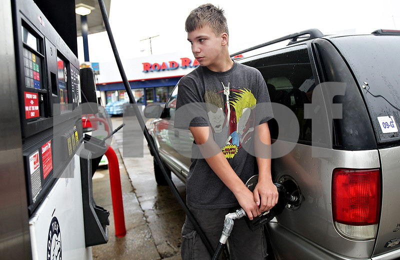 Monica Maschak - mmaschak@shawmedia.com<br /> Matt Bowers, of DeKalb, pumps gas into his sister's Chevy Blazer at the Road Ranger gas station in DeKalb on Tuesday, July 30, 2013. The price of unleaded gas was $3.68 per gallon.