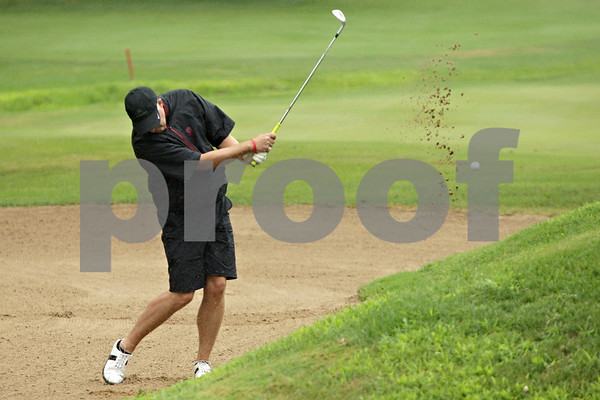 Rob Winner – rwinner@shawmedia.com<br /> <br /> Brett Vietmeier of DeKalb chips a ball out of a sand trap within inches of the ninth hole at the Kishwaukee Country Club in DeKalb, Ill., Friday, July 26, 2013.
