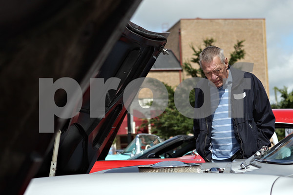 Rob Winner – rwinner@shawmedia.com<br /> <br /> Sycamore resident Ken Pumfrey looks over a Corvette during a car show at the Frank Van Buer Plaza in downtown DeKalb, Ill., Saturday, July 27, 2013, as part of Kishwaukee Fest.