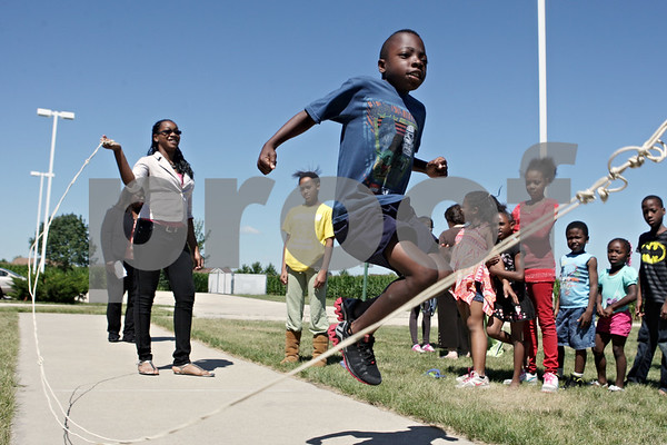 "Rob Winner – rwinner@shawmedia.com<br /> <br /> Dana Brisbon, 9, jumps rope at ""New Hope Academy,"" an enrichment program for children at New Hope Missionary Baptist Church, on Thursday afternoon in DeKalb, Ill. The program, which lasted four weeks, taught children math and reading skills."