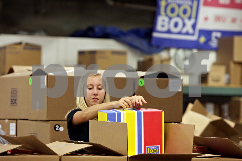 Rob Winner – rwinner@shawmedia.com<br /> <br /> Michelle Findlay repacks a box of school supplies heading to an Alabama school later this week at School Tool Box in Sycamore, Ill., Tuesday, July 30, 2013.