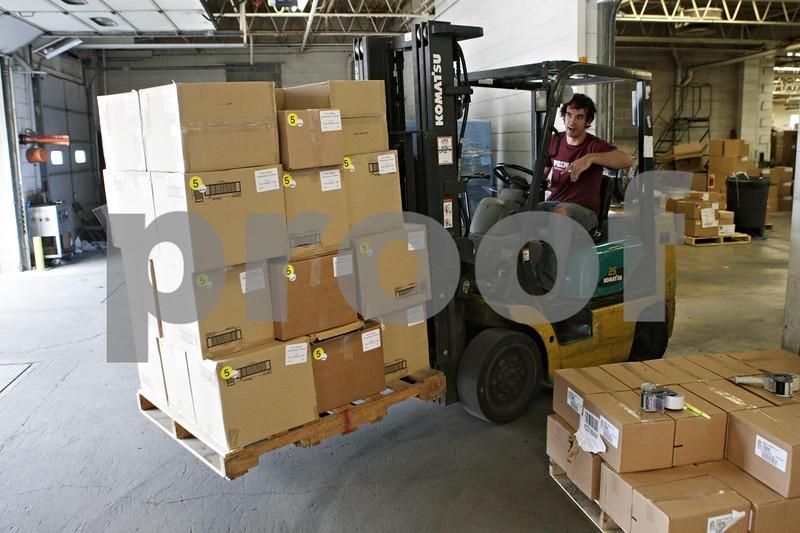 Rob Winner – rwinner@shawmedia.com<br /> <br /> Forklift driver James High prepares school supply shipments at School Tool Box in Sycamore, Ill., Tuesday, July 30, 2013. School Tool Box ships school supplies to over 40 states.