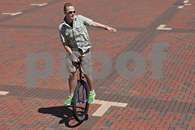 Rob Winner – rwinner@shawmedia.com<br /> <br /> Brian O'Connor of DeKalb rides his unicycle at the Frank Van Buer Plaza in downtown DeKalb, Ill. Wednesday, July 24, 2013. O'Connor is starting a new business, One Wheel Promotions, which will have him riding on his unicycle and advertising for local businesses.