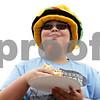 Rob Winner – rwinner@shawmedia.com<br /> <br /> Cortland resident Ethan Cohen, 13, enjoys a bacon cheeseburger during BaconPalooza at the Frank Van Buer Plaza in downtown DeKalb, Ill., Saturday, July 27, 2013, as part of Kishwaukee Fest.