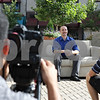 Rob Winner – rwinner@shawmedia.com<br /> <br /> Miguel Sierra (left), director of photography, sets up his shot as Dan Kapper (right), assistant, speaks to Brian Oster, production manager of OC Imageworks, as Oster sits on a coach waiting to be interviewed near the corner of First Street and Lincoln Highway in downtown DeKalb, Ill., Monday, July 29, 2013. The three were filming bios that will appear on the OC Imageworks website.