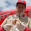 Rob Winner – rwinner@shawmedia.com<br /> <br /> Doug Eaton of Boy Scout Troop 4 prepares a bacon wrapped frank skewer at the start of BaconPalooza at the Frank Van Buer Plaza in downtown DeKalb, Ill., Saturday, July 27, 2013, as part of Kishwaukee Fest.