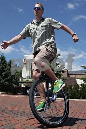 Rob Winner – rwinner@shawmedia.comBrian O'Connor of DeKalb rides his unicycle at the Frank Van Buer Plaza in downtown DeKalb, Ill. Wednesday, July 24, 2013. O'Connor is starting a new business, One Wheel Promotions, which will have him riding on his unicycle and advertising for local businesses.
