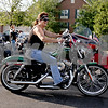 Monica Maschak - mmaschak@shawmedia.com<br /> Robin Murtaugh, of Sycamore, pulls into the parking lot on her 2013 72 Sportster for a bike night held by Midwest Women Riders at Cabana Charley's on Thursday, August 1, 2013. All proceeds from the night went to Safe Passage, a domestic violence shelter. Midwest Women Riders inspires, promotes and encourages female motorcycle riders and also emphasizes the importance of other motorists seeing motorcycles.