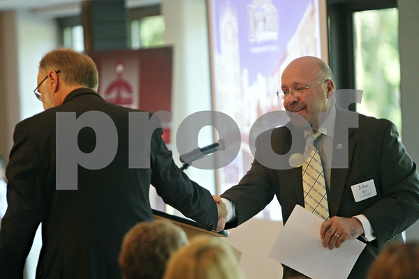 Rob Winner – rwinner@shawmedia.com<br /> <br /> Northern Illinois University President Doug Baker (left) shakes hands with DeKalb Mayor John Rey during the state of the city meeting on Thursday morning at the Hopkins Park Community Center in DeKalb, Ill.