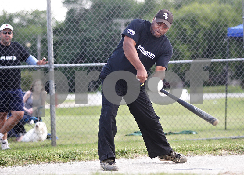 Monica Maschak - mmaschak@shawmedia.com<br /> Vernon English, of Darien, swings at the ball during a charity softball game at Suppeland Park in Cortland on Friday, August 2, 2013. The DeKalb County Democrats played against the DeKalb County Republicans to raise money for Kishwaukee United Way.