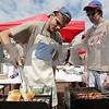 Rob Winner – rwinner@shawmedia.com<br /> <br /> Robert Searls (left), 16, of Boy Scout Troop 4 toasts bread as fellow scout Matthew Eaton, 17, watches at the start of BaconPalooza at the Frank Van Buer Plaza in downtown DeKalb, Ill., Saturday, July 27, 2013, as part of Kishwaukee Fest.