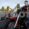 "Monica Maschak - mmaschak@shawmedia.com<br /> DeKalb Harley Davidson Parts Associate Justin Wiltse watches as Brian Rosenquist, of Sycamore, tests out the new Harley Davidson Softail Slim hooked up to a ""Jumpstart"" at a bike night held by Midwest Women Riders at Cabana Charley's on Thursday, August 1, 2013. All proceeds from the night went to Safe Passage, a domestic violence shelter. Midwest Women Riders inspires, promotes and encourages female motorcycle riders and also emphasizes the importance of other motorists seeing motorcycles."