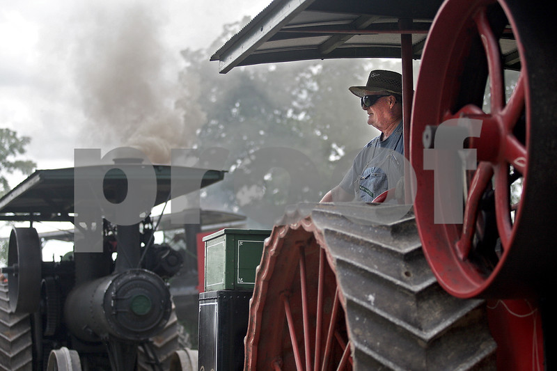 Monica Maschak - mmaschak@shawmedia.com<br /> Pat Noonan, of Lemont, waits on a 1913 Port Huron Steam Engine for the parade to start at the opening day of the annual Threshing Bee in Sycamore on Thursday, August 8, 2013.