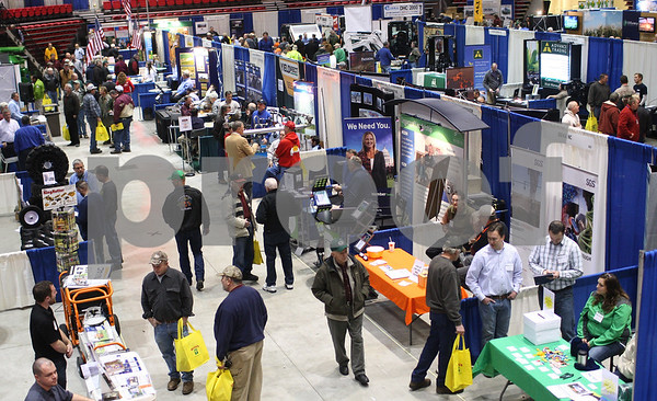 Shaw Media file photo<br /> <br /> Visitors explore the Northern Illinois Farm Show at the Convocation Center on Thursday, Jan. 10, 2013.