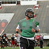 Rob Winner – rwinner@shawmedia.com<br /> <br /> Quarterback Jordan Lynch warms up with his teammates during the start of the first practice of the season at Northern Illinois University in DeKalb, Ill., Monday, Aug. 5, 2013.