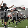 Rob Winner – rwinner@shawmedia.com<br /> <br /> Offensive lineman Ryan Brown stretches during the start of the first practice of the season at Northern Illinois University in DeKalb, Ill., Monday, Aug. 5, 2013.