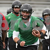 Rob Winner – rwinner@shawmedia.com<br /> <br /> Quarterback Jordan Lynch carries the football during a drill at the first practice of the season at Northern Illinois University in DeKalb, Ill., Monday, Aug. 5, 2013.
