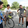 Monica Maschak - mmaschak@shawmedia.com<br /> Brandon Morris, 24, and Garrett Morris, 21, from the Los Angeles area make a pit stop in DeKalb on Saturday, August 3, 2013. The Morris brothers are biking from Oregon to New York in efforts to raise funds for a San Luis Obispo non-profit called Project Hope and Fairness. Project Hope and Fairness is focused on ending the injustices of the cocoa trade by empowering cocoa farmers in Africa and shortening the distance between those who eat chocolate and those who grow the beans. Here, they show one of the chocolate bars to Lisa Royer, Diane Finn and Kelly Thompson, who greeted the men on their entrance to DeKalb.