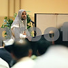 Rob Winner – rwinner@shawmedia.com<br /> <br /> Wahbeh Taweel speaks to members of the Islamic Society of Northern Illinois University during Eid al-Fitr marking the end of Ramadan inside the Duke Ellingtion Ballroom on the campus of NIU in DeKalb, Ill., Thursday, Aug. 8, 2013.