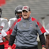 Rob Winner – rwinner@shawmedia.com<br /> <br /> Defensive line coach Brett Diersen instructs his players during a drill at the first practice of the season at Northern Illinois University in DeKalb, Ill., Monday, Aug. 5, 2013.