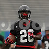 Rob Winner – rwinner@shawmedia.com<br /> <br /> Running back Keith Harris Jr. carries the football during a drill at the first practice of the season at Northern Illinois University in DeKalb, Ill., Monday, Aug. 5, 2013.
